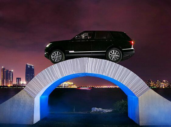RANGE ROVER MARKS 45 YEARS OF ENGINEERING INNOVATION WITH JAW DROPPING DRIVE ACROSS PAPER BRIDGE
